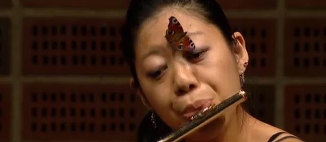 flute_performer _between_eyebrows_butterfly